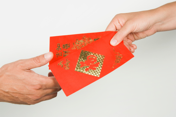 Hong bao or ang pao in red money packets or envelopes